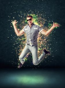 Free Jumping Smiling Young Man On Glowing Background Stock Photo - 20121580