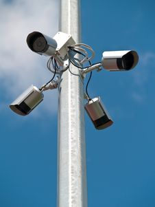 Four Surveillance Cameras Vertically Stock Images