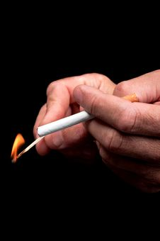 Men S Hand Lights A Cigarette Royalty Free Stock Image