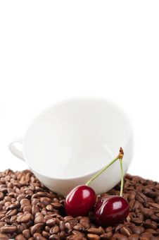 Free Cup With Coffee Beans And Cherry Stock Photo - 20123390