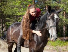 Free A Girl With Her Hair Stroking Horse Royalty Free Stock Images - 20125959