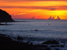 Free Spectacular Sunset Over Rocky Surfbeach Royalty Free Stock Photos - 20126798