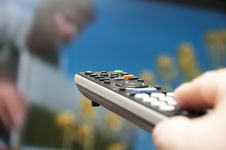 Free Hand Holding TV Remote Control. Stock Photos - 20127363