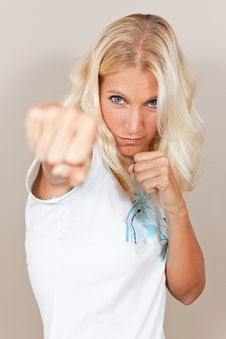 Young Attractive Woman Attacks With A Punch Stock Image