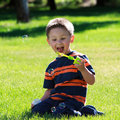 Free Little Boy Looking On Soap Bubbles Stock Image - 20139101