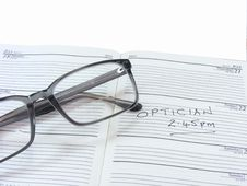 Free Spectacles On A Diary Royalty Free Stock Photo - 20135865