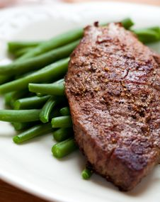 Beefsteak With French Beans Royalty Free Stock Photos