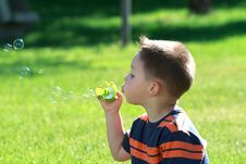 Free Little Boy Blowing Soap Bubbles Stock Images - 20138734