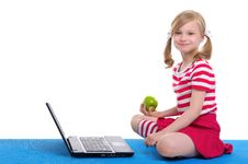Free Girl With An Apple And Laptop Sitting On Rug Royalty Free Stock Photography - 20139727