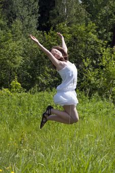 Free Girl Jumping  In A Meadow Stock Photos - 20142193