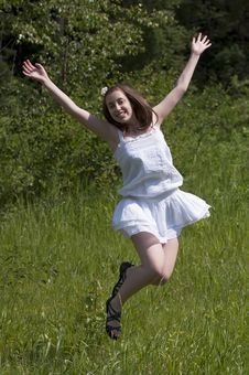 Free Girl Jumping  In A Meadow Royalty Free Stock Photo - 20142515