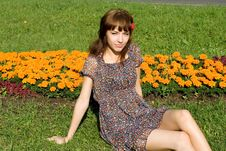 Free Beautiful Girl Sitting On Meadow Stock Photo - 20143060