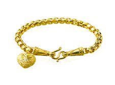 Golden Bracelet In Heart Shape Stock Photography