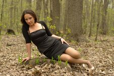 Free Girl Sitting On A Stump Royalty Free Stock Photo - 20148635