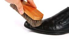 Hand With Brush Cleaning Shoe Royalty Free Stock Photography