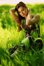Free Brunette Sitting On Green Grass Royalty Free Stock Image - 20155996