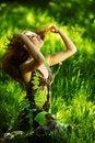 Free Brunette Sitting On Green Grass Stock Image - 20156001