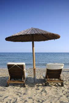 Umbrella And Two Chairs Over The Sea Royalty Free Stock Photos