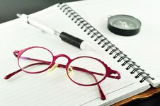Free Notebook With Pen And Glasses Stock Image - 20153711