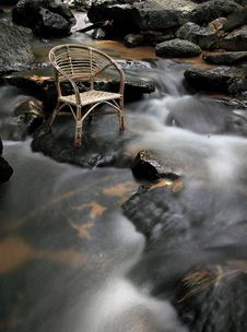 Long Exposure Rattan Chair At Waterfall Stock Photography