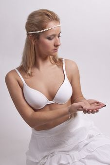 Beautiful Girl With A Pearl Ornament On Here Head Royalty Free Stock Photography