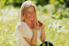Woman Playing With A Butterfly Stock Photos