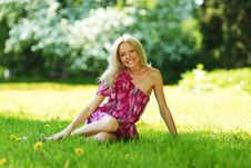 Free Blonde Sitting On Green Grass Stock Photography - 20155992