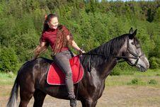 Free Beautiful Girl On Black Horse Stock Photography - 20160702