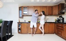 Free Happy Young Couple Have Fun In Modern Kitchen Stock Photo - 20161210