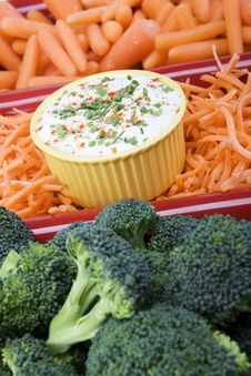 Variety Of Raw Carrots And Broccoli In A Red Ceram Royalty Free Stock Photos