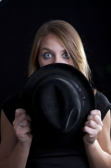 Free A Blond Girl Looking Over The Hat Royalty Free Stock Image - 20164506