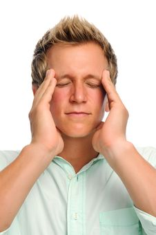 Man With Headache In Studio Royalty Free Stock Image