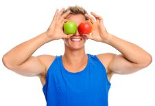 Free Happy Sportsman With Two Apples Royalty Free Stock Photo - 20167405