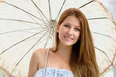 Portrait Of A Beautiful Girl With Umbrella