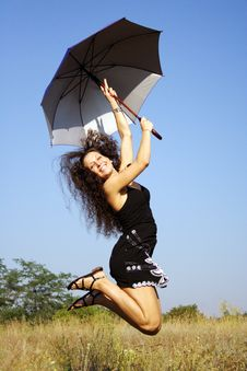 Happy Girl Jumping With Umbrella Royalty Free Stock Photo