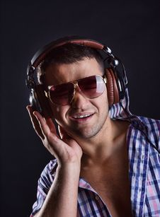 Happy Man Is Listening Music Stock Image