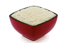 Free A Red-Black Dish Full Of Raw Rice Stock Photography - 20180442