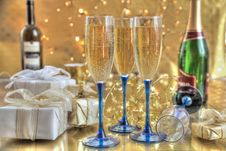 Free Champagne In Glasses, Gift Boxes And Lights Stock Images - 20182264