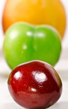 Free Three In A Row; Cherry, Plum And Apricot On A Whit Stock Image - 20184381