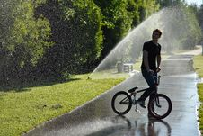Free Boy With Bmx Stay On Fountain Splashes Background Royalty Free Stock Image - 20184426
