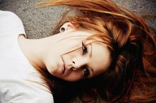Free Portrait Of Beautiful Young Girl Lying On Asphalt Royalty Free Stock Photography - 20186037