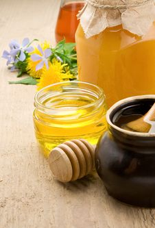 Honey In Jars And Flower On Wood Stock Images