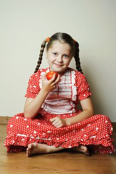 Girl With Tomato Stock Photography