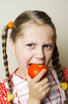 Free Girl With Red Tomato Stock Photo - 20187420