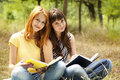 Free Girlfriends Doing Homework At The Park. Royalty Free Stock Photography - 20196547