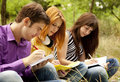 Free Students At Outdoor Doing Homework. Royalty Free Stock Photo - 20196765