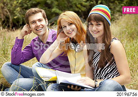 Free Students At Outdoor Doing Homework. Royalty Free Stock Image - 20196756
