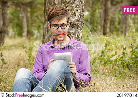 Free Funny Men With Glasses Doing Homework At The Park Stock Images - 20197014