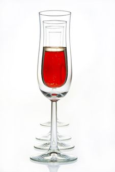 Glasses With Red Champagne And Empty Glasses Stock Images