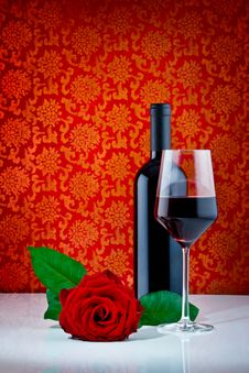 Bottle Of Wine With Glass And Rose Stock Photo